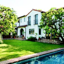 Rear facade of a Spanish Colonial Revival residence in Holmby Hills