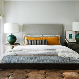Guest bedroom with pillows covered with Pollack fabric