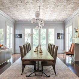 Modern Traditional Dining Room with Reflective Glossy Walls and Ceiling Detail