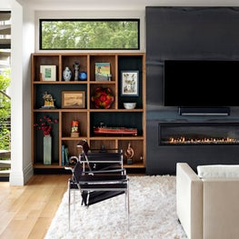 Blackened Cold Role Steel-Wrapped Fireplace, built-in shelves