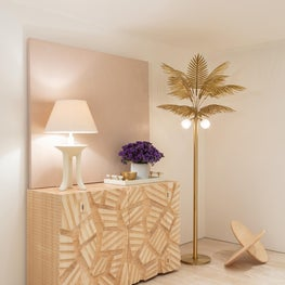 Cool beachy summer vibes / This brutalist console sits perfectly along the cool palm tree floor lamp of this chic Miami Beach entrance hallway.