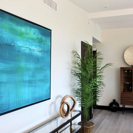entry/turquoise art/black and glass console/wood and glass storage piece
