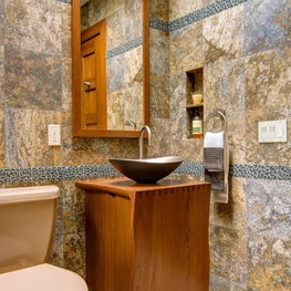 Tile and stone composition: custom Asian vanity and metal vessel sink