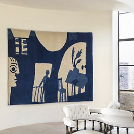 The entry of this Modern Mediterranean home includes this woven Picasso image