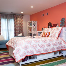 Youthful colors and patterns play well together in a young girl's bedroom.