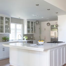 Open plan white kitchen