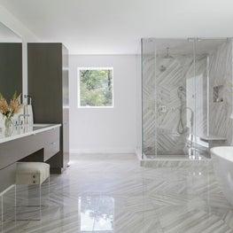 Elegant contemporary white bathroom with custom grey tile work