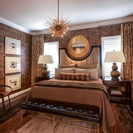 Monochromatic Bedroom with Gold Accents and Custom Linens