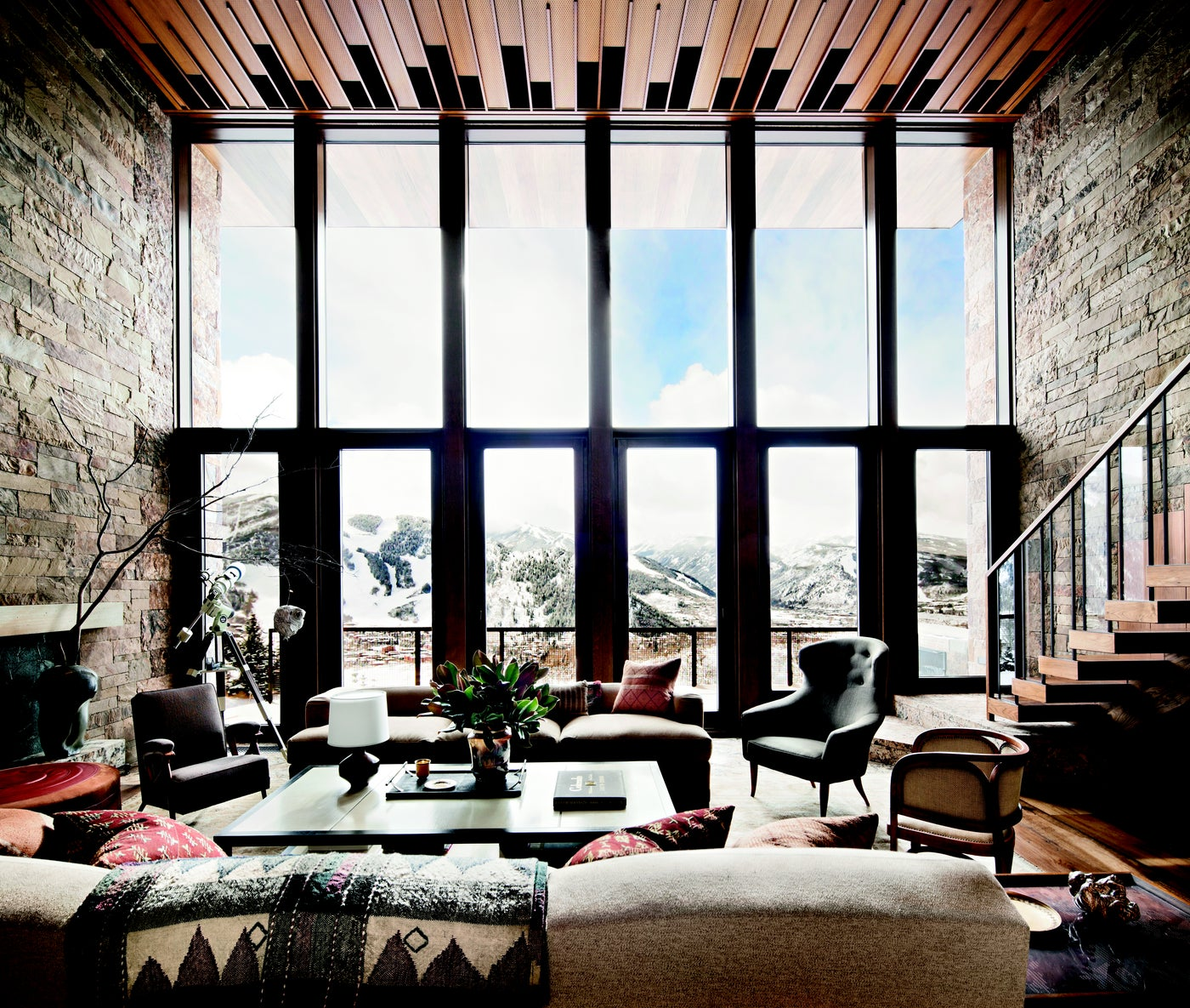 A double height living room with sweeping views of Red Mountain in Aspen.