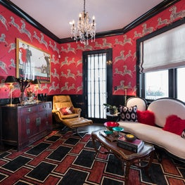 Eclectic red and black Sitting Room with vintage furniture