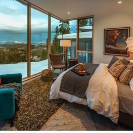 Mountain modern master bedroom with views of the slope