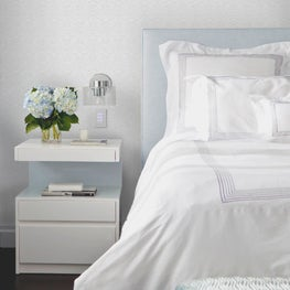 Pale Blue Charlotte's Lace Wallpaper by Brett Design, Inc in a tranquil bedroom.