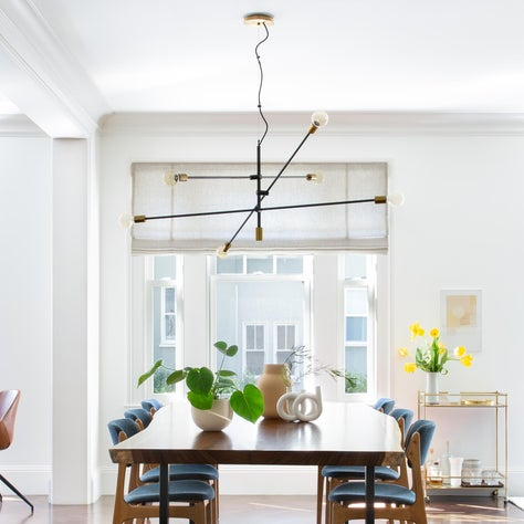 Modern SF Condo with Live-Edge Dining Table and Industrial Pendant Light