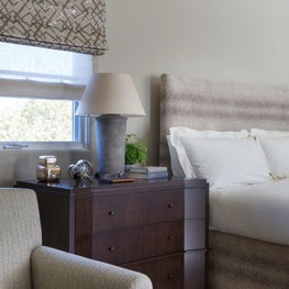 Custom oak stained bedside cabinets and an upholstered bed create a calmness in this palette of taupes and grays in the Master Bedroom - Los Altos Hills Residence