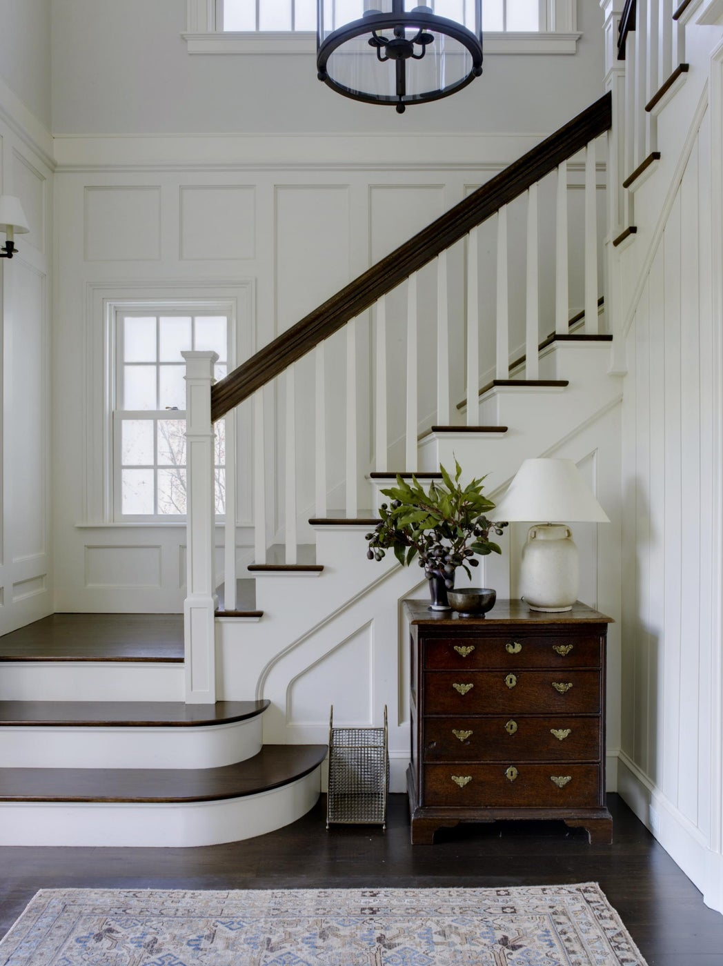 A simple stair case with wall paneling
