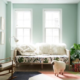 Tropical-Scandinavian nursery and little girl's bedroom on Park Avenue