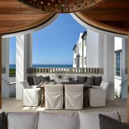 Cypress custom gates open to an outdoor loggia overlooking the Gulf of Mexico