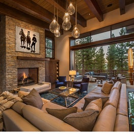 Living room with floor-to-ceiling window walls at Martis Camp residence