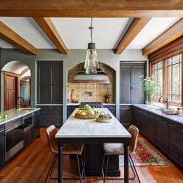 An Italian inspired kitchen in a Craftsman home blends aesthetics for a welcoming and warm family space.
