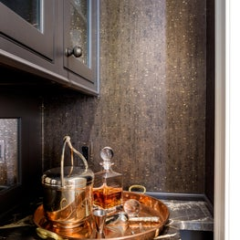 Cork wallcovering and Lusso Nero marble countertop with copper tray set.