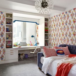 Teenage girl's bedroom with bright pops of color and modern furniture