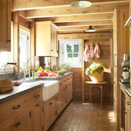 "A ""granary"" kitchen features custom-fabricated cabinets in rustic white oak."