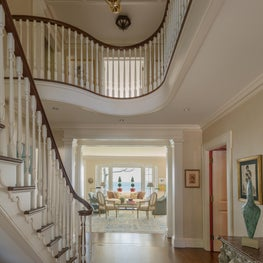 The redesign changed the stairway direction, making a more graceful entryway.