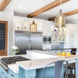 Modern Farmhouse Kitchen Featuring High- low Bar style Island and pendant lights