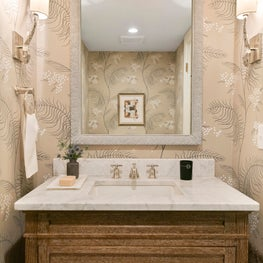 North End Boise powder room with floral wallpaper, branch sconces and limed wood