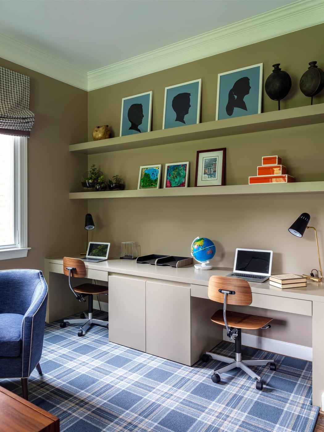 Home office with built-in workstation and walnut desk chairs