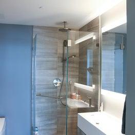 San Francisco Infinity Towers modern remodel. Guest bathroom, limestone shower.
