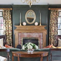 English Country custom paneling,pine FP mantel,brass chandelier, crystal mirror