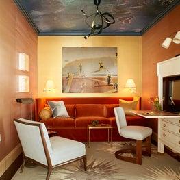 Map Room with Custom Art, Lighting and Furnishings.