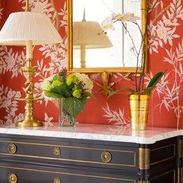 Red printed wallpaper foyer vignette