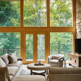 Treehouse Above The Lake | Custom Modular Sectional Overlooking High Windows