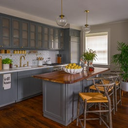 Kitchen Island with Grey Cabinetry, Hard Wood Counter and Woven Seagrass Stools