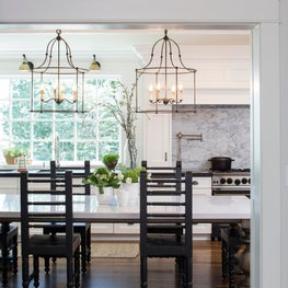Georgian home, bright white with iron light fixtures.