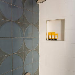 Handsome guest shower with a neutral blue tiled wall
