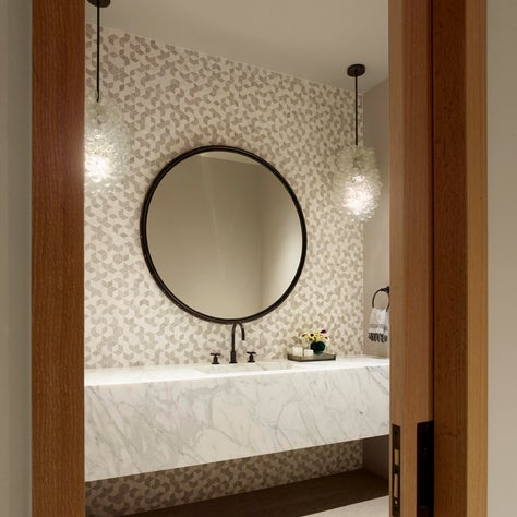 Tahoe Marvel, main powder room with a marble floating vanity.