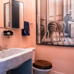 Powder Bathroom with marble washstand, venetian plaster, and triptych mirror