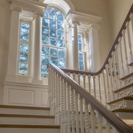 This staircase features custom millwork, as does a classical window frame.