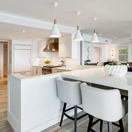 Oceanside Cottage Kitchen with Cantilevered Quartz Waterfall Island