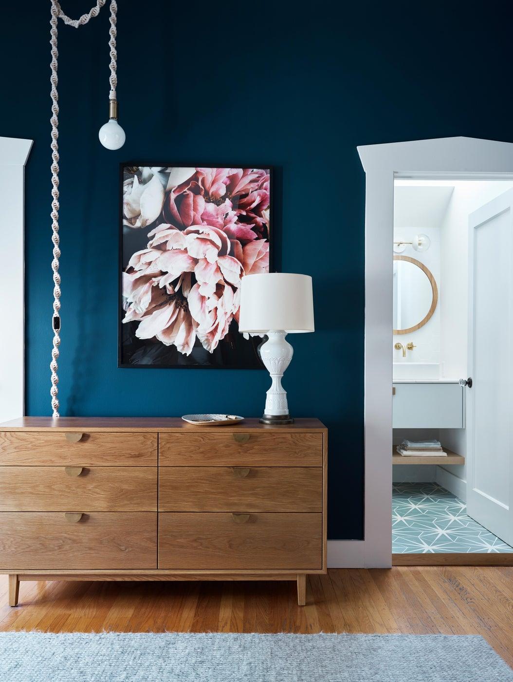 master bedroom, navy paint, dark walls, white oak dresser, rope light