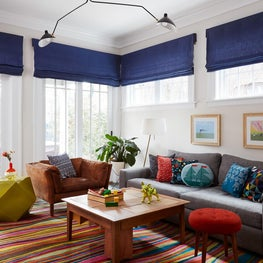Evanston Family Room with Brightly Colored Rug and Serge Mouille Light