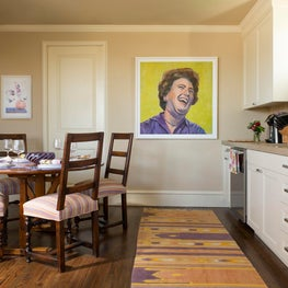 Julia Child wearing purple in this fun cottage kitchen