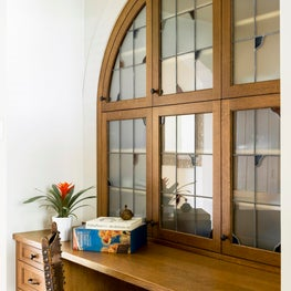 A work station with leaded glass cabinetry
