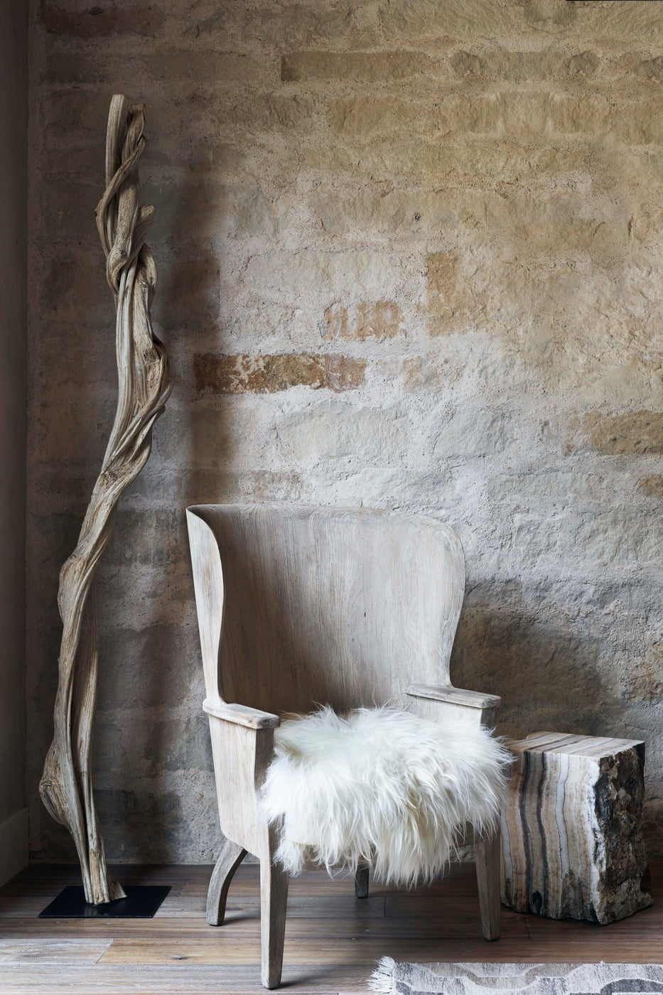Formation wingback barrel chair is a great place to sit in this Sonoma Farmhouse