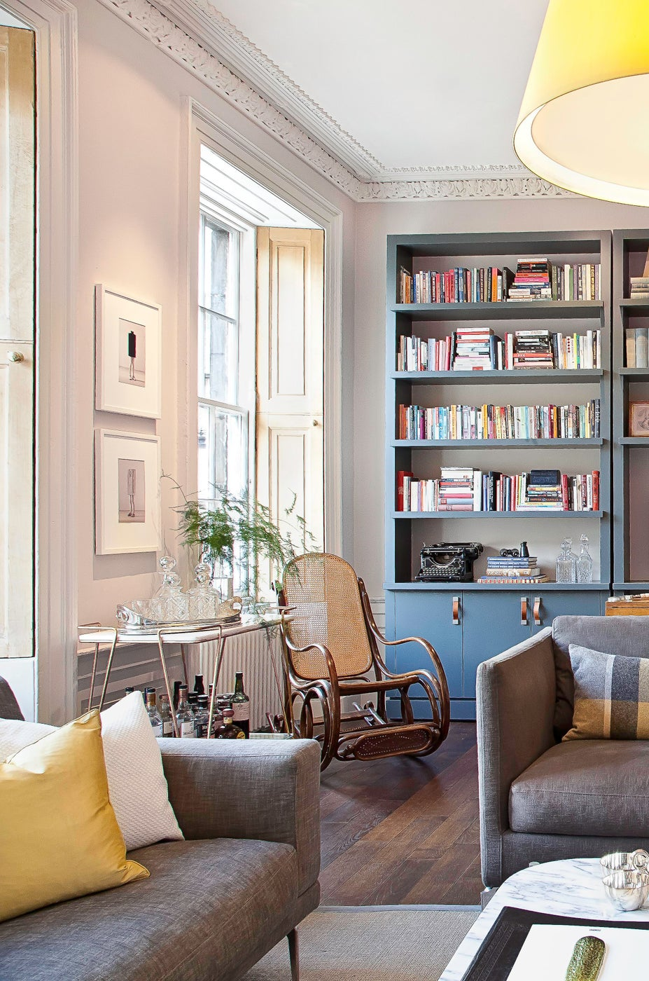 Grand Room with beautiful custom bookshelves, high ceilings and tons of light!