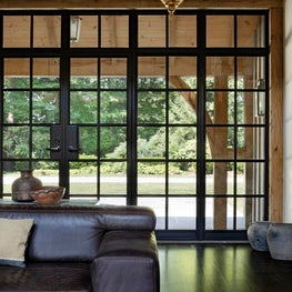 Sitting Room with floor to ceiling steel windows