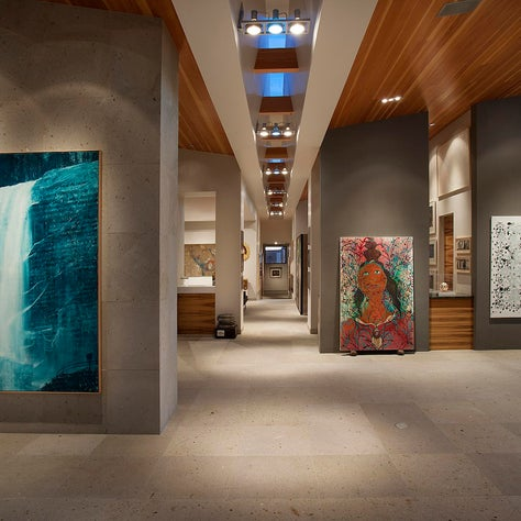 A butterfly roof with skylights illuminates the entry gallery art collection